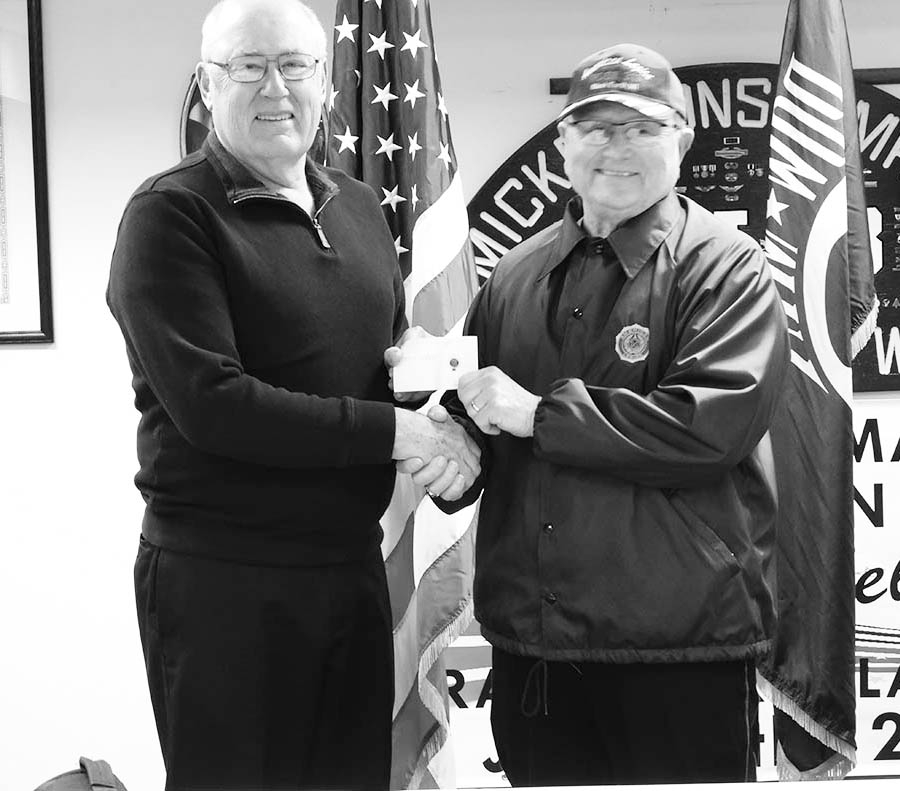 Vern Wendt received his pin from Commander Dennis J. Wood, for 50 years of continuous service to Mickelsons-Martin American Legion Post 313.